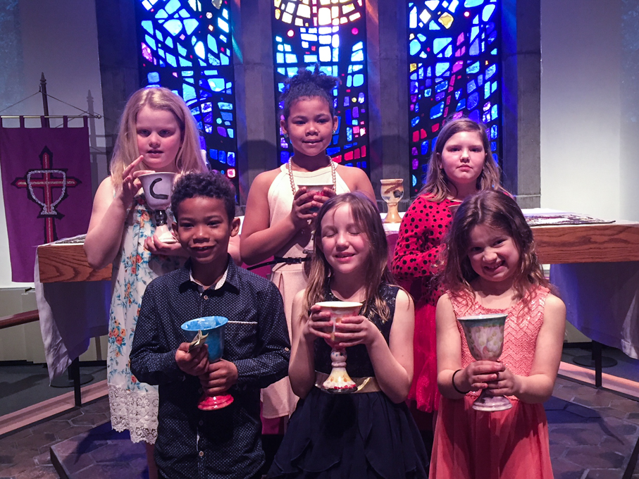 Children holding chalices